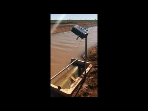 Portable timer opening an irrigation gate