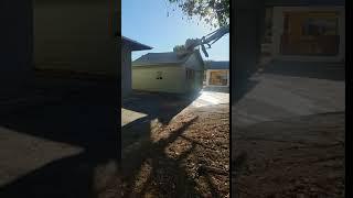 Excavator Demoing Garage in Escondido