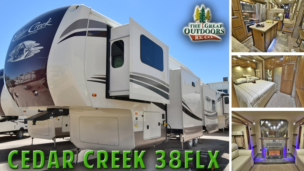 Front living room 2018 forest river cedar creek 38flx cc279 fifth wheel colorado dealer