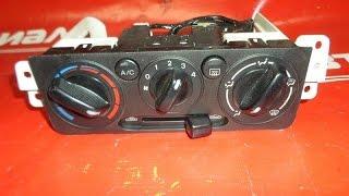 Заміна лампочок підсвічування в блоці управління клімату на Mazda Demio 2000-2002 рік