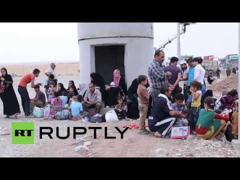Iraq: Residents flee Mosul after ISIS fighters seize control