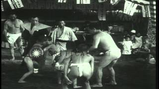 13 year old Iwao Takeda, wins sumo wrestling Junior mat title in Ikegami, Japan. HD Stock Footage