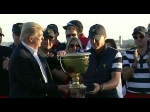 Trump dedicates golf trophy to people of Puerto Rico