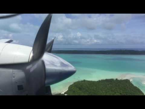 Flying over Aitutaki Lagoon, Cook Islands, on Air Rarotonga SAAB 340