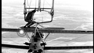Lieutenant Wayer descends from USS Akron (ZRS-4) to a hooked-up N2Y-1 training pl...HD Stock Footage