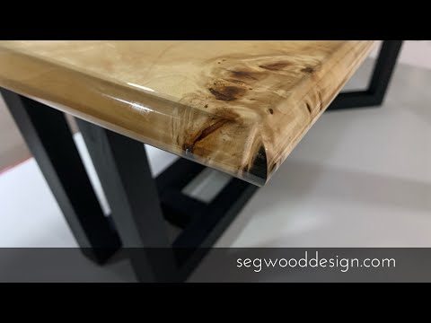 DIY epoxy coffee table - poplar wood, black epoxy base, clear epoxy resin.