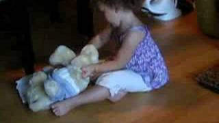 Rianna diapers her bear