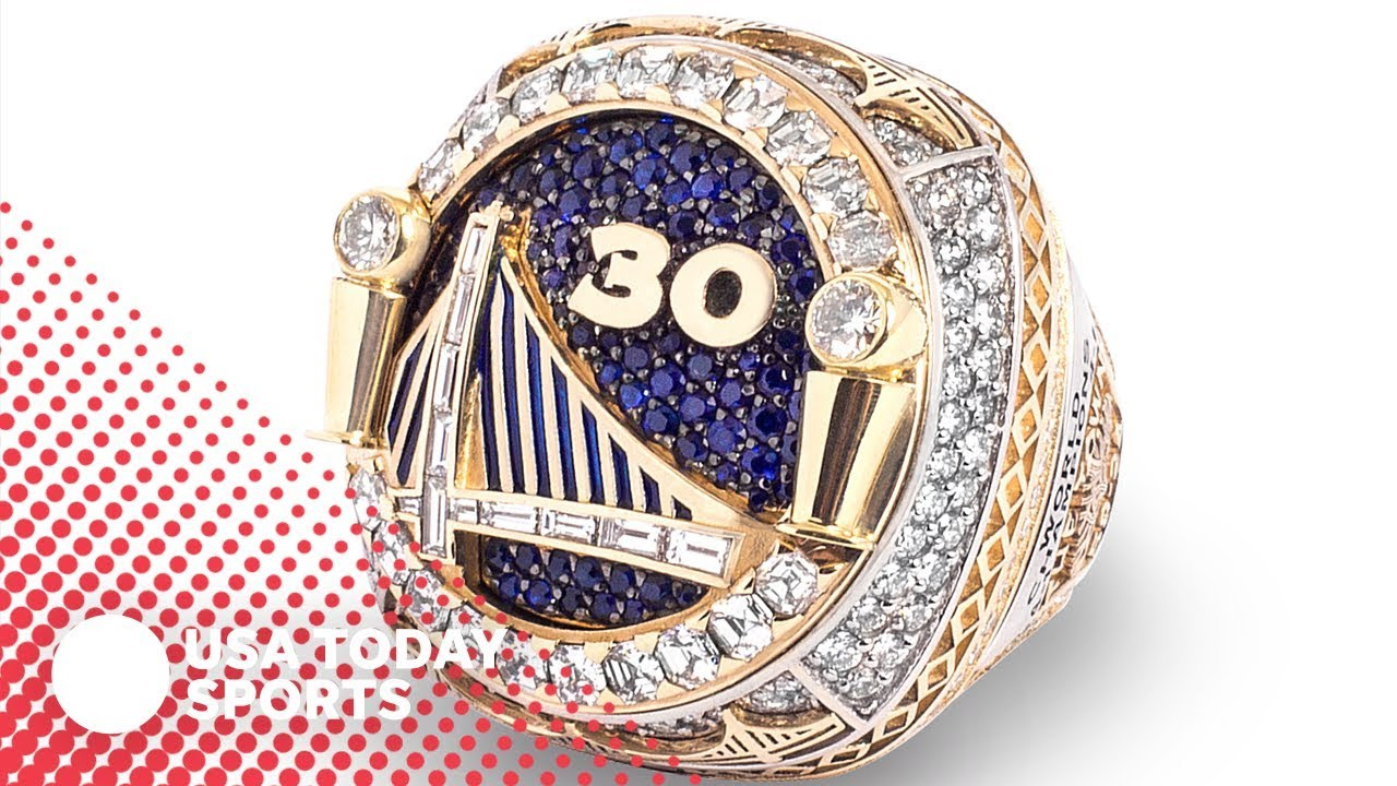 Golden State Warriors don reversible NBA title rings