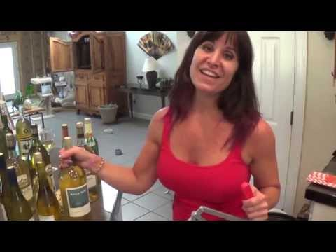 Hot 48 year old mom gives some Farm Girl wisdom while bottling wine. From the mouths of babes!