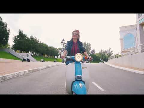 happy young hipster woman in glasses driving a vintage scooter in city slow motion r0gijn5o1x  D