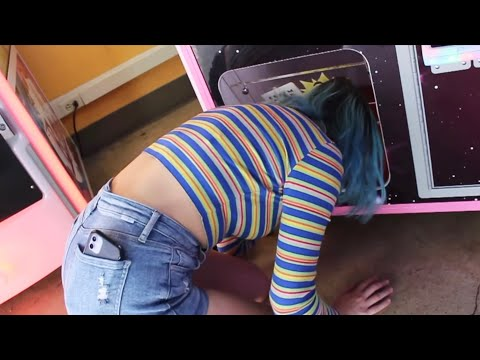 STUPID GIRL CLIMBS IN ARCADE CLAW MACHINE!!