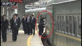 Cleaning on the go? Bodyguards wipe Kim's train as it arrives at Vladivostok station