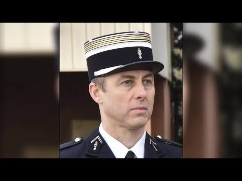 French police officer who took hostage's place in supermarket attack dies