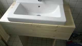 This video is not available. simple DIY wooden sink cabinet