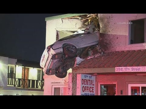 Flying car!! Car goes airborne, slams into 2nd floor of California office