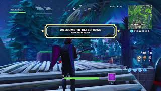 Building glitch in Fortnite Battle Royale inside of Tilted town