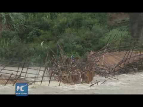 RAW: Flood washes away iron rod bridge in SW China