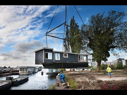 Floating on Dry Land: 17 Derelict Houseboats Find New Home Located in the north of Amsterdam