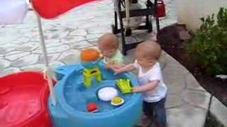 Babies Splashing In The Water