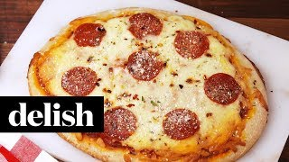 Get the full recipe here: http://www.delish.com/cooking/recipe-ideas/recipes/a55258/slow-cooker-pizza-recipe/ INGREDIENTS 1 lb. pizza dough 1 c. pizza sauce ...