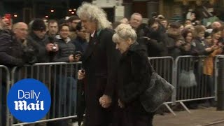 Queen guitarist Brian May arrives at Stephen Hawking's funeral