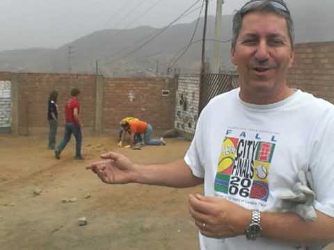 Putting electrical wiring in Hope House, outside of Lima, Peru