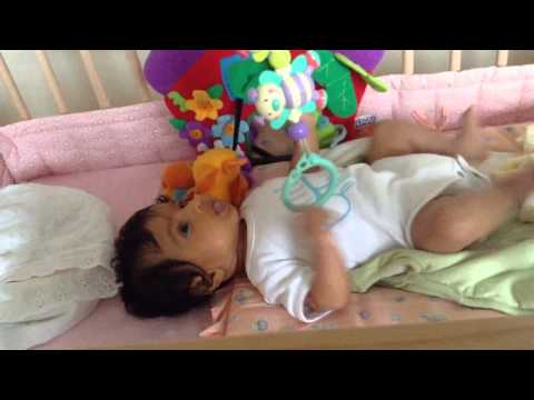 Anoushka playing with cot mobiles