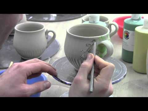 Ben Carter Decorating A Mug With Under Glazes And