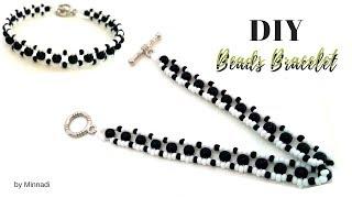 how to make a beaded bracelet.  white and black beaded bracelet.  beginner beading project