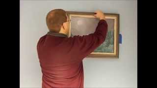 How to hang a picture without putting marks on the wall