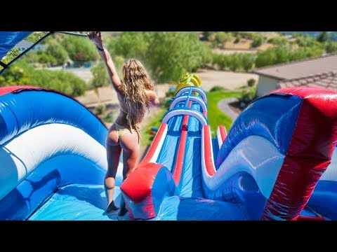 WORLD'S LARGEST BACKYARD WATERSLIDE! (100ft+)