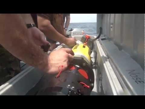 British Royal Navy Sailors use an autonomous underwater vehicle