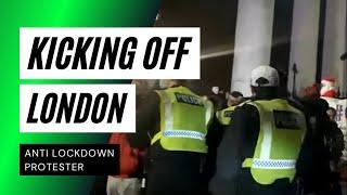 Riot Police arrest Anti-lockdown and Million Mask March protestors in Trafalgar Square, London