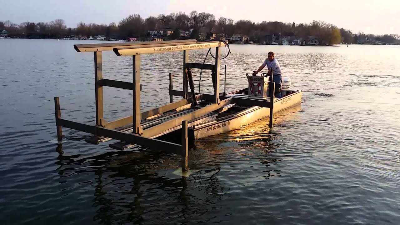 Lake Tractor Picking up and placing boat lift. - YouTube