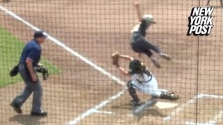 Softball player scores with unbelievable leap