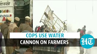Police use water cannon, tear gas on agitating farmers near Delhi-Haryana border