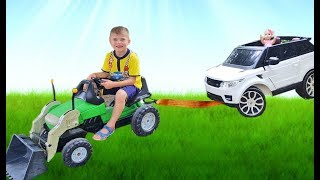 Rinat with tractor helps Dominika on car drive car