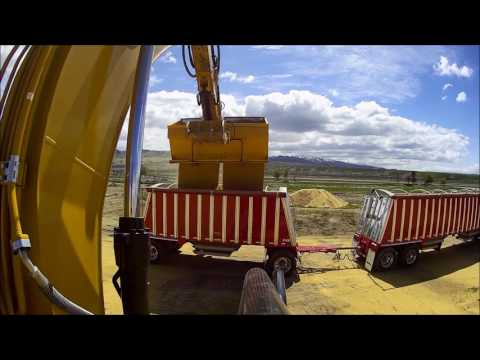 Excavating Wheat 200 Bushel's Per Scoop With  A Caterpillar 336E Grainscavator