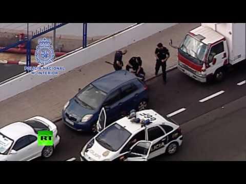 RAW: Spanish police take down axe-wielding man