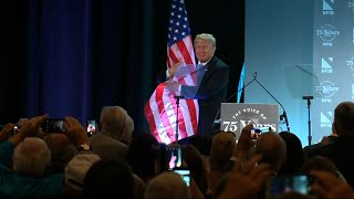 Trump Hugs Flag After Immigration Speech