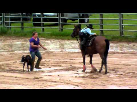 Youth honor past riders in muddy, rainy day of rodeo