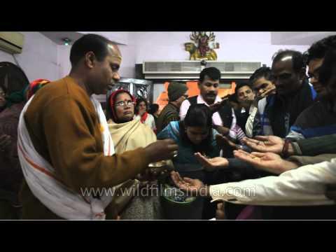 Priest distributing