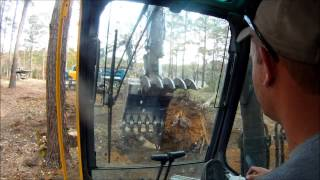 Excavator Clearing Land