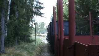 Norwegian Steam locomotives working up a steep hill with a freight train
