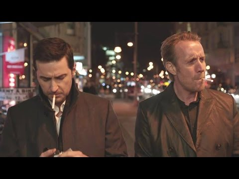 Hector and Daniel smoking in 'Berlin Station' Series (Rhys Ifans, Richard Armitage)