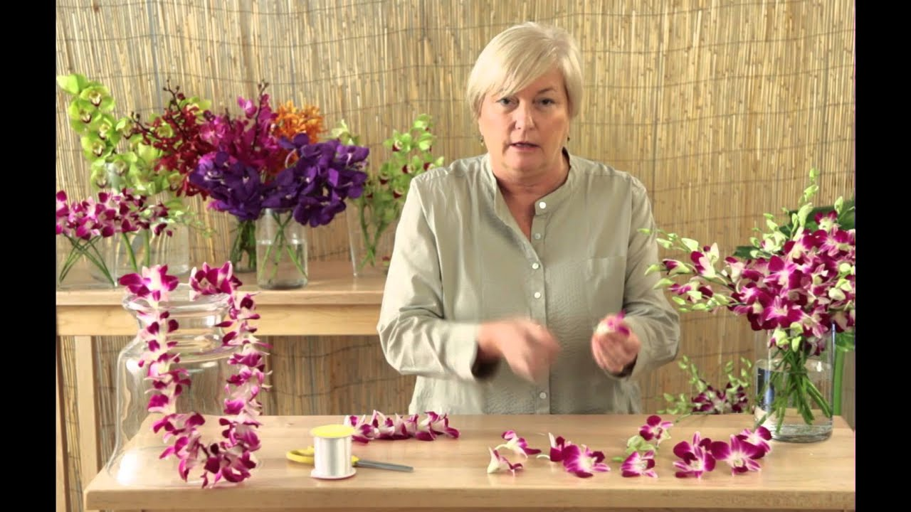 How to make a lei with orchids youtube izmirmasajfo