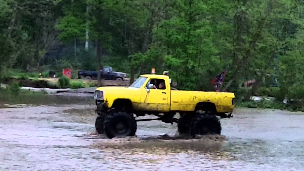 Old Lifted Trucks >> Monster truck playing in Flooded Creek - YouTube