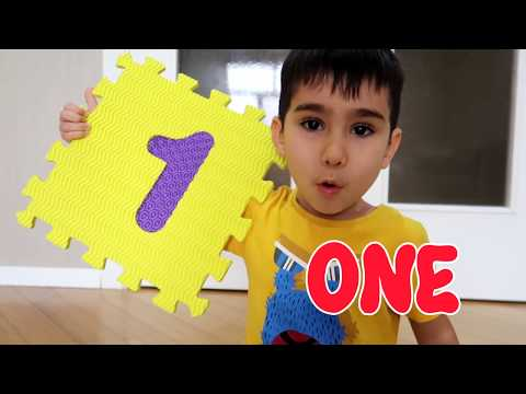 Baby Build a tall tower with squishy ABC foam puzzle for children. Learn and Play