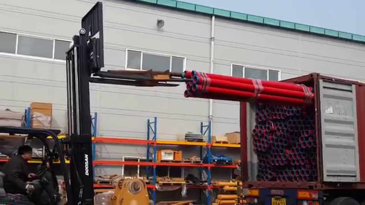 Discharging Concrete Pipes From Container Youtube