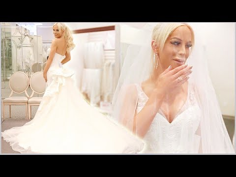 TRYING ON WEDDING DRESSES | Gigi